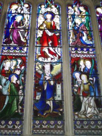 Women in Christ's service, window in church in England/Photo by author